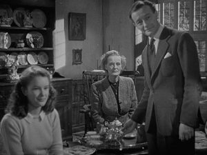 House-owner Elliot Foley (Roland Culver) and his guests are drawn into Craig (Mervyn Johns)'s nightmare in Ealing's horror anthology Dead of Night (1945)