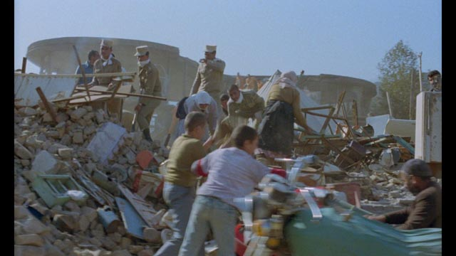 Survivors clear away the rubble in order to rebuild their broken lives in Abbas Kiarostami's And Life Goes On (1992)