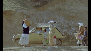 The Director (Farhad Kheradmand) tries to find a way back to Koker through the earthquake devastation in Abbas Kiarostami's And Life Goes On (1992)