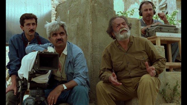 The Director (Mohammad Ali Keshavarz) is frustrated that his non-professional actors can't seem to get their lines right in Abbas Kiarostami's Through the Olive Trees (1994)
