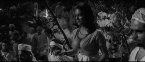 The silent Karim (Marie Devereux) enjoys the spectacle of torture in Terence Fisher's The Stranglers of Bombay (1959)