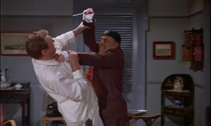Capt. Sale (Geoffrey Toone) is attacked by Charles Lloyd Pack as a murderous Chinese doctor in Anthony Bushell's The Terror of the Tongs (1961)