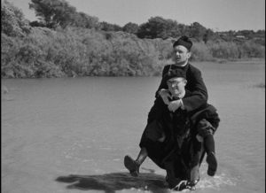 The Leftist teacher (Robert Bassac) and the Priest (Robert Vattier) set aside their differences in order to restore social order in Marcel Pagnol's The Baker's Wife (1938)