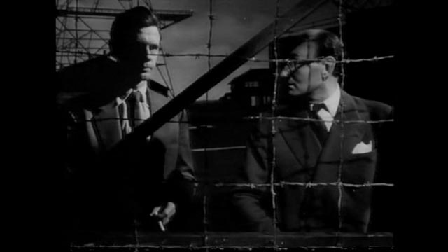 Heathley (James Donald) and project head Professor Carrington (Maurice Denham) disagree on the risks of a test flight in Anthony Asquith's The Net (1953)