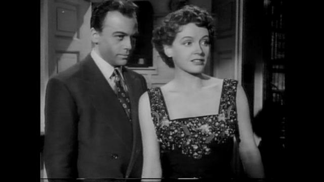 Team member Alex Leon (Herbert Lom) hopes to take Heathley (James Donald)'s place in Lydia (Phyllis Calvert)'s affections in Anthony Asquith's The Net (1953)