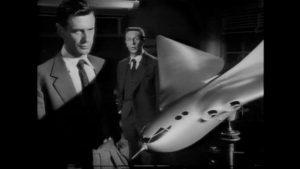 Michael Heathley (James Donald) has idealistic hopes for his experimental plane, the M-7, in Anthony Asquith's The Net (1953)