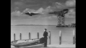 Heathley (James Donald) and Brian (Patric Doonan) take the M-7 up for a test flight without authorization in Anthony Asquith's The Net (1953)
