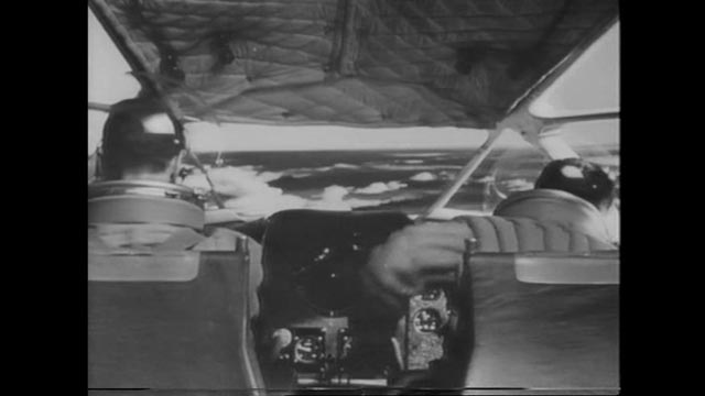 Heathley (James Donald) loses control of the plane during the fight in Anthony Asquith's The Net (1953)