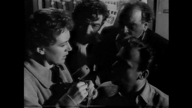 Lydia (Phyllis Calvert)'s voice over the radio brings Heathley (James Donald) back from the brink of disaster in Anthony Asquith's The Net (1953)
