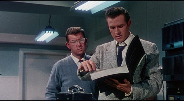Cal Meacham (Rex Reason) is intrigued by the mysterious tech catalogue in Joseph Newman's This Island Earth (1955)