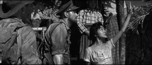 The Burmese villagers are initially welcoming in Val Guest's Yesterday's Enemy (1959)