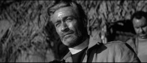 Guy Rolfe as the Chaplain whose moral clarity is shaken by the reality of war in Val Guest's Yesterday's Enemy (1959)