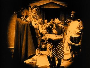 A slave market in the romanticized Old South in D.W. Griffith's Birth of a Nation (1915)