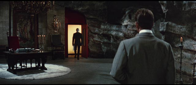 Reporter Fandor (Jean Marais) meets the mastermind (also Marais) in his lair in Andre Hunebelle's Fantomas (1964)