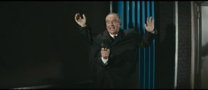 Louis de Funes as Commissioner Juve demonstrates one of his gadgets in Andre Hunebelle's Fantomas Unleashed (1965)