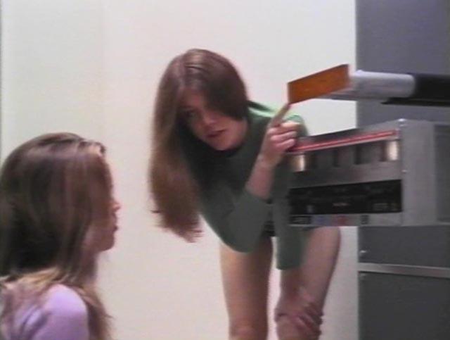 Isa (Caroline Hildebrand) explains the time machine's controls to her sister Karen (Kelley Bohanon) in Peter Fonda's Idaho Transfer (1973)