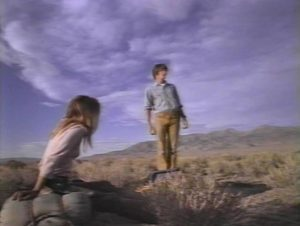 Karen (Kelley Bohanon) and Ronald (Kevin Hearst) search for signs of human survival in Peter Fonda's Idaho Transfer (1973)