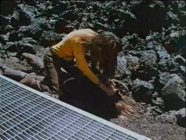 A crazed fellow time traveler tries to kill Karen (Kelley Bohanon) in Peter Fonda's Idaho Transfer (1973)