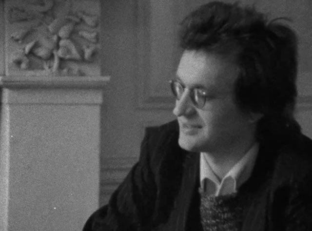 Wim Wenders listens to Charlie (Charles Gormley)'s pitch in Maurice Hatton's Long Shot (1977)