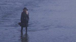 A mysterious woman stalks serial killer Dennis Skinner in Ivan Nagy's Skinner (1993)