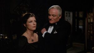 Charles Gray tries to charm a perplexed Katherine Ross in Richard Marquand's The Legacy (1978)