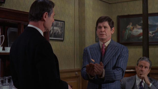 Joe (Charles Bronson) is initiated into the Family in Terence Young's The Valachi Papers (1972)