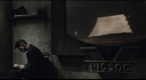 Winston Smith (John Hurt) records his illicit thoughts just out of sight of the viewscreen in Michael Radford's 1984 (1984)