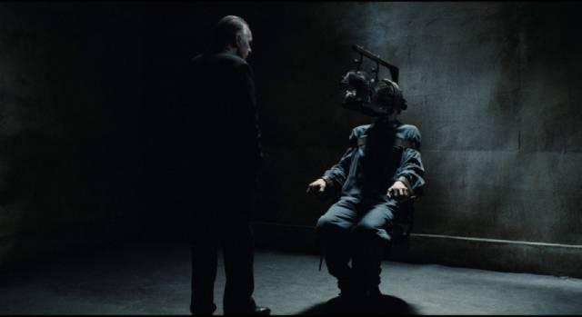 O'Brien (Richard Burton) shows no animosity towards Winston Smith (John Hurt) as he tortures him in Michael Radford's 1984 (1984)
