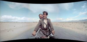 Fred and Beatrice Troller explore the wide open spaces of the Southwest in Cinerama Holiday (1955)