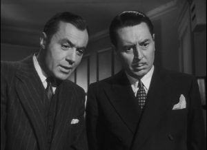Adam (Charles Boyer) and Hilary Ames (Reginald Gardiner) have very different reactions ...