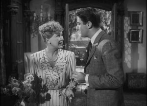 Feckless Andrew Carmel (Peter Lawford) tells his Mother (Margaret Bannerman) to expect the arrival of refugee Adam Belinski (Charles Boyer) in Ernst Lubitsch's Cluny Brown (1946)