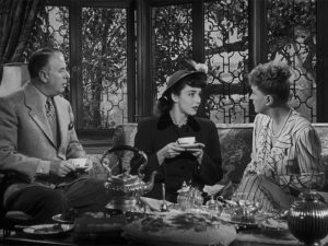 Sir Henry Carmel (Reginald Owen) and Lady Alice (Margaret Bannerman) mistake Cluny (Jennifer Jones) for one of their own class in Ernst Lubitsch's Cluny Brown (1946)