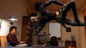 Light Yagami (Tatsuya Fujiwara) is encouraged by the demon who gave him deadly power in Shusuke Kaneko's Death Note (2006)