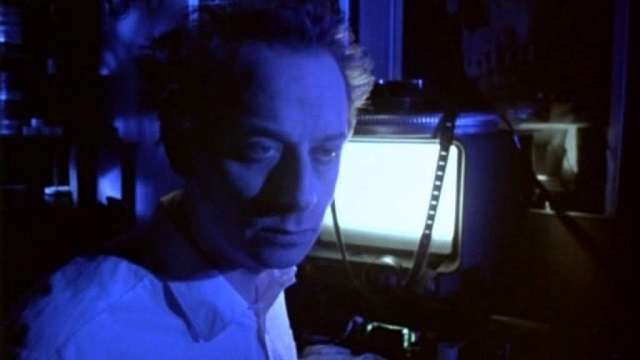 Johan Rudebeck as a film editor driven mad by cheap gore and sex in Anders Jacobsson's Evil Ed (1995)
