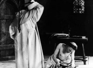 Inquisitors scourge their flesh to exorcise thoughts of sex in Benjamin Christensen's Haxan (1922)