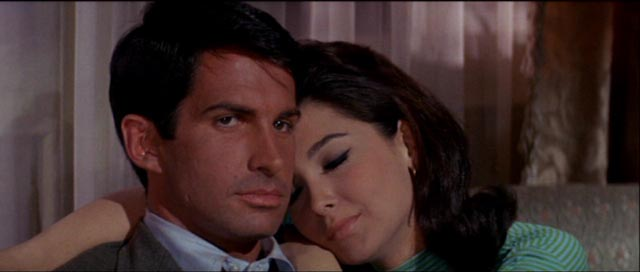 Jim Tanner (George Hamilton) and Margery Lansing (Suzanne Pleshette) hide out at an all-night swingers party in Byron Haskin's The Power (1968)