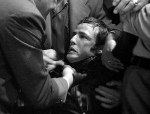 The good townsfolk get rough with Johnny (Marlon Brando) in Laslo Benedek's The Wild One (1970)