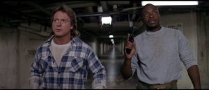 Roddy Piper and Keith David take on alien invaders in John Carpenter's They Live (1988)