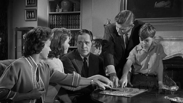 The Zorba family (Donald Woods, Rosemary DeCamp, Jo Morrow and Charles Herbert) and lawyer Rush (Martin Milner) try out the Ouija board in William Castle's 13 Ghosts (1960)