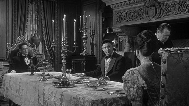 Dr. Cargrave (Ronald Lewis) has an uneasy meal with the Baron (Guy Rolfe) and Maude (Audrey Dalton) in William Castle's Mr. Sardonicus (1961)