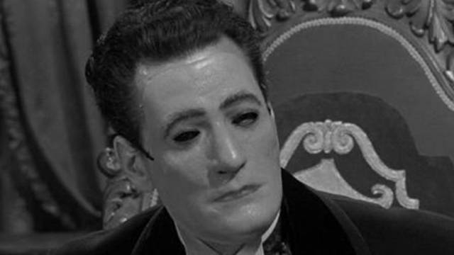 The Baron (Guy Rolfe) conceals his rigid features behind a mask in William Castle's Mr. Sardonicus (1961)