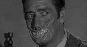 The Baron (Guy Rolfe)'s living death mask in William Castle's Mr. Sardonicus (1959)