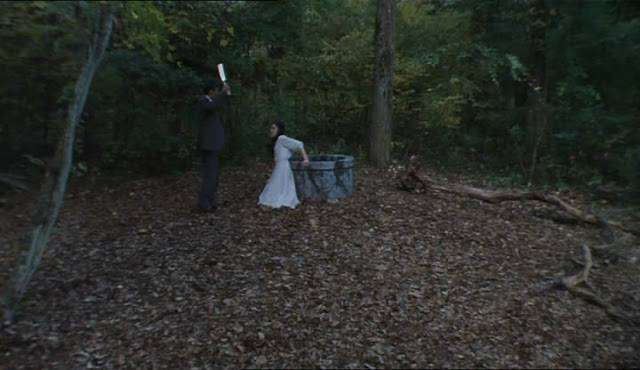 Dr. Heihachirô Ikuma (Daisuke Ban) sets the curse in motion by tossing Sadako (Yukio Nakama) down the well in Norio Tsuruta's Ring 0 (2000)