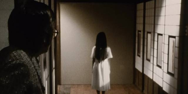 Sadako (Rie Ino'o) standing still with long hair and back turned evokes menace and mystery in Norio Tsuruta's Ring 0 (2000)