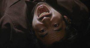 ... and scares Ryuji (Hiroyuki Sanada) to death in Hideo Nakata's Rinhu (1998)