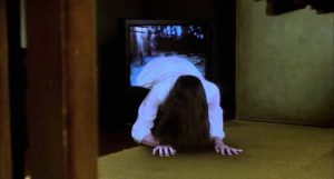 Sadako (Rie Ino'o) crawls out of the TV in Hideo Nakata's Ringu (1998)