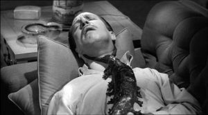 Dr. Chapin (Vincent Price) falls prey to the critter once he's set it free in William Castle's The Tingler (1959)