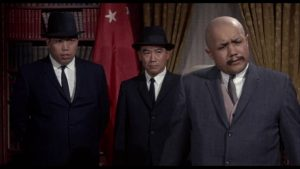 Khigh Dhiegh as sinister Chinese attache Kang in William Castle's 13 Frightened Girls (1963)