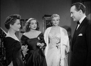 Addison DeWitt (George Sanders) arrives at the party with his young protege Miss Caswell (Marilyn Monroe) in Joseph L. Mankiewicz's All About Eve (1950)
