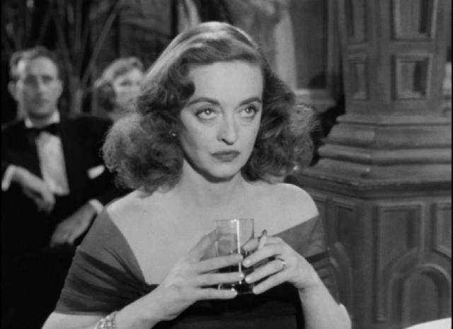 Margot (Bette Davis) cedes the spotlight to Eve (Anne Baxter) at the Sarah Siddons Society awards banquet in Joseph L. Mankiewicz's All About Eve (1950)